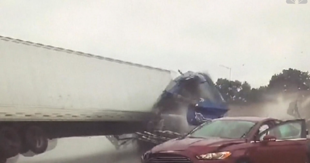 Semi-truck crashes into tow truck, rolls over Wisconsin highway