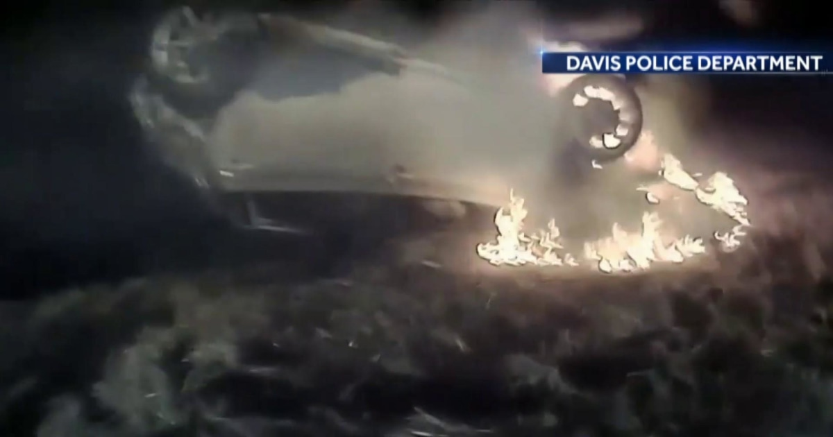 Police officer saves woman from fiery crash in dramatic rescue thumbnail