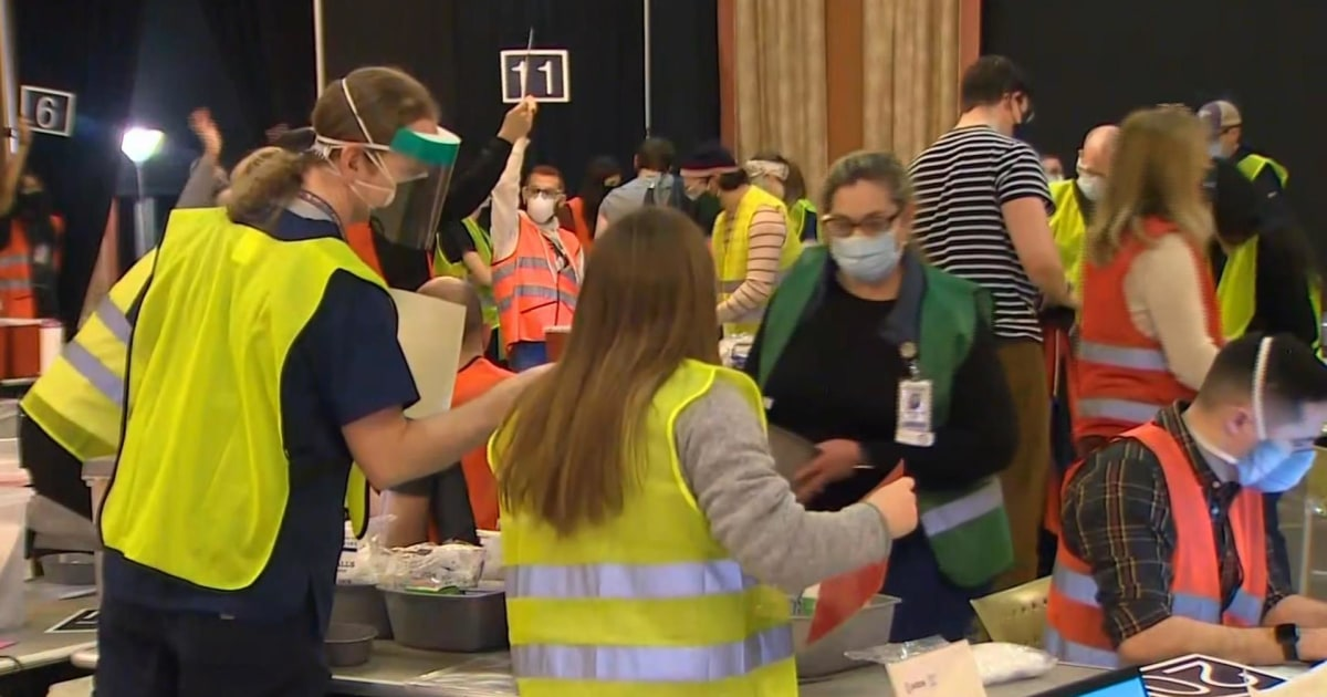Broken freezer leads to late night rush for Covid vaccinations in Seattle