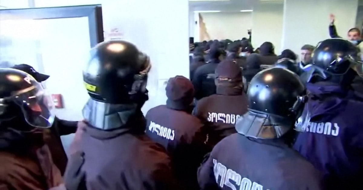 Georgia police storm opposition headquarters to detain leader thumbnail