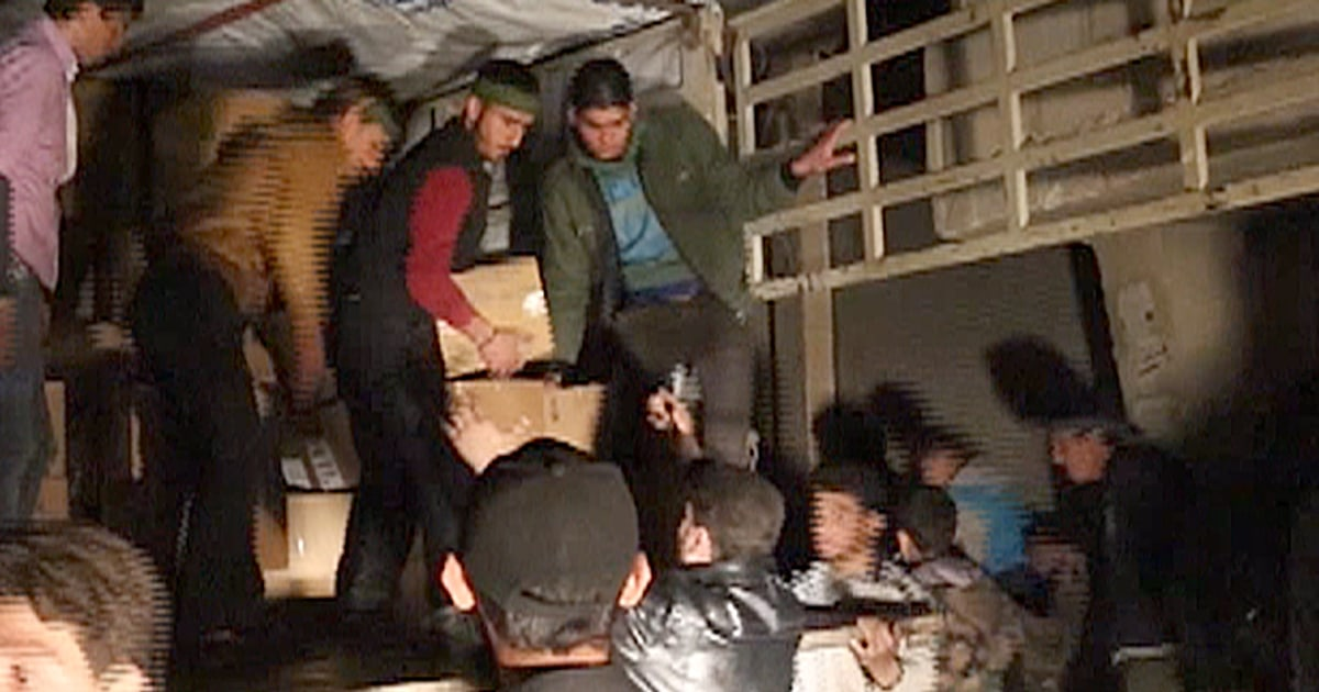 hungry children greet aid trucks in besieged syrian town of moadamiyeh