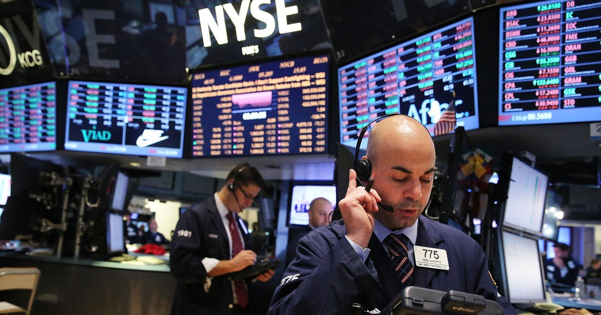 Dow Closes at All-Time High with Boost from the Federal Reserve