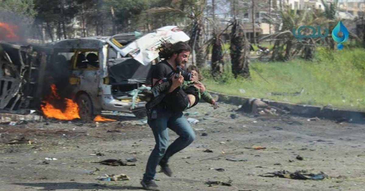 Syrian Civil War: Photo of Photographer's Rescue Goes Viral