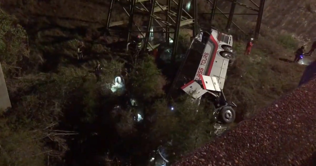 Bus carrying teens crashes off interstate into ravine; 1 dead, 20 hurt