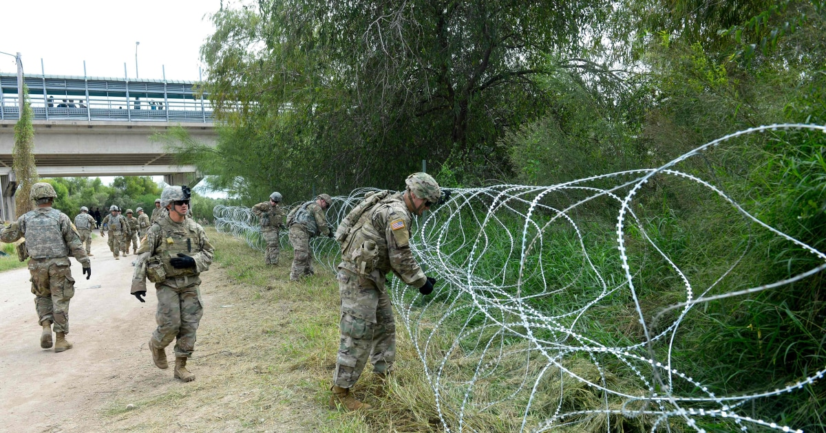 Sent by Trump, soldiers arrive at border as migrant caravan