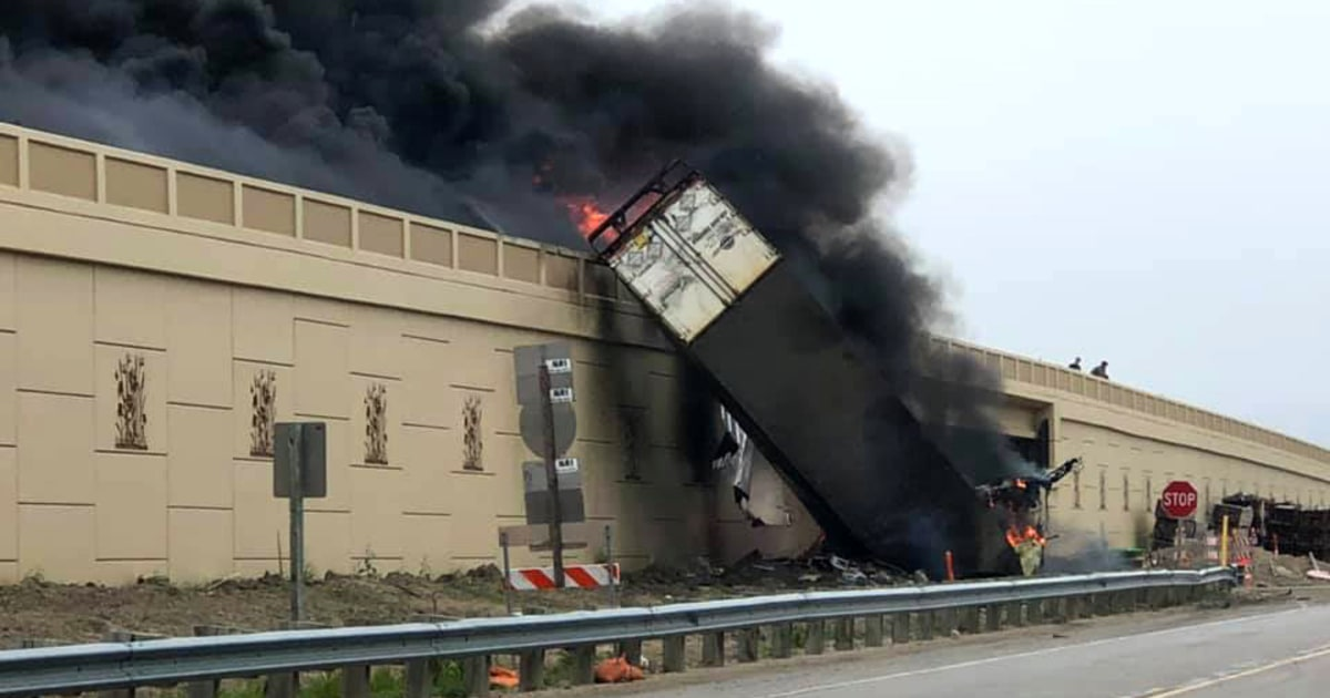 At least two people killed, semitruck flipped over in fiery