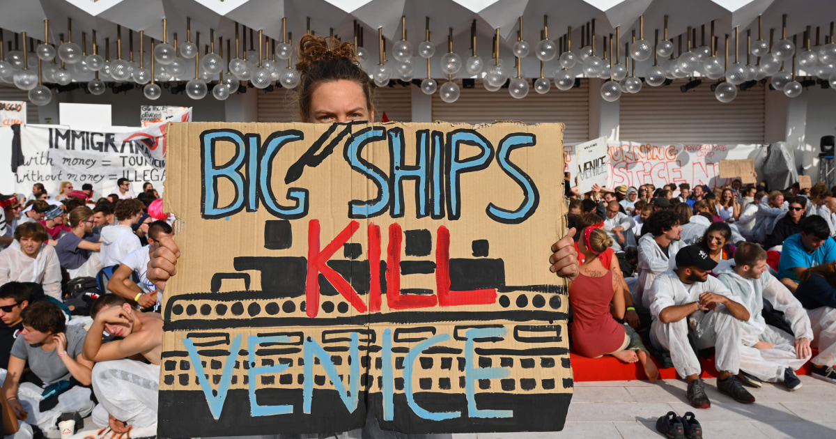 Climate change activists storm red carpet at Venice Film Festival: 'Our home is on fire' - NBC News