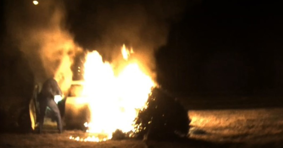 Video shows woman rescued from burning car in Virginia