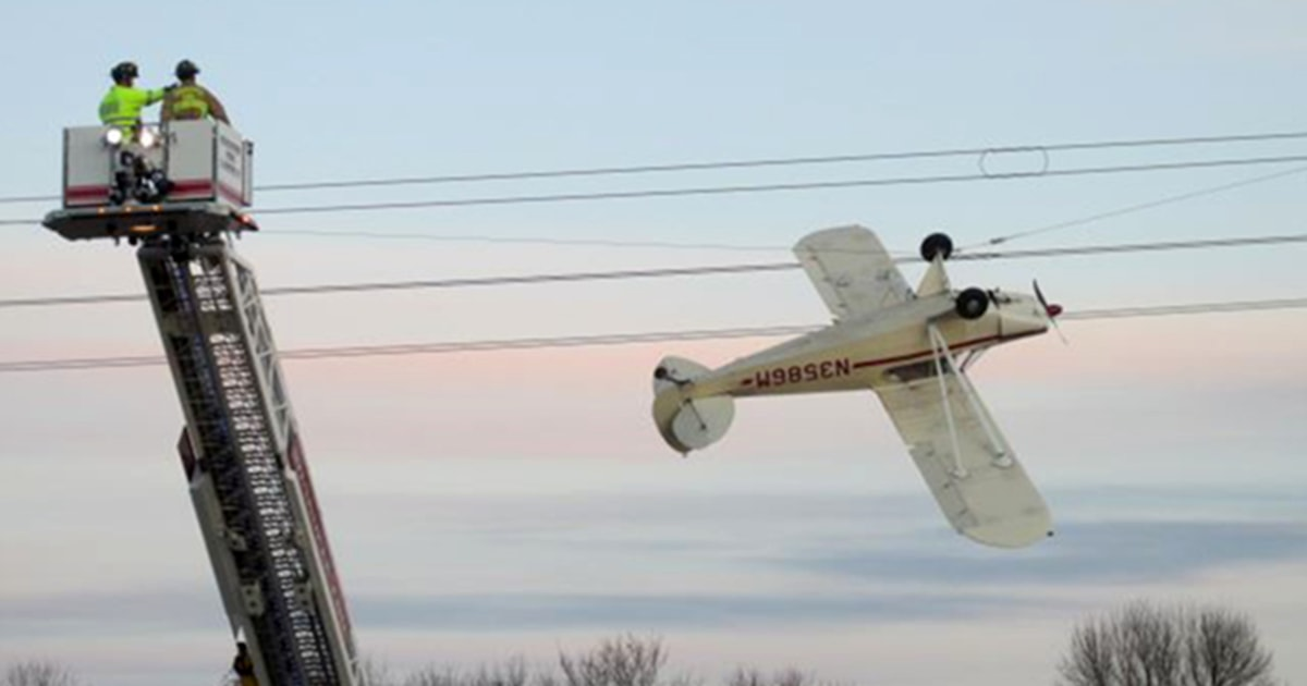 Plane precariously dangles upside down from power lines in Minnesota