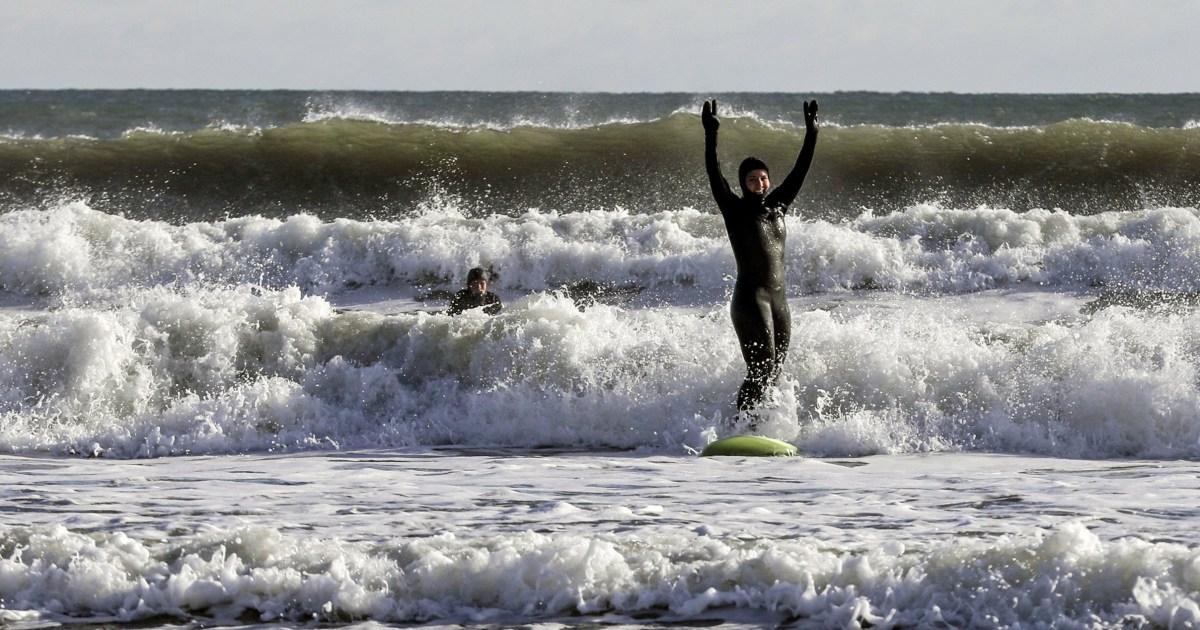 Tulsi Gabbard membuat splash — berselancar di pembekuan New Hampshire