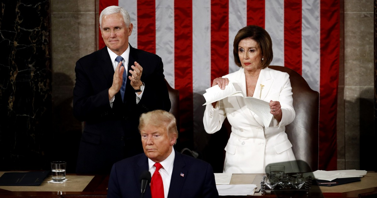 Standing behind Trump, Nancy Pelosi rips up a copy of his State of the Union speech right after he finishes
