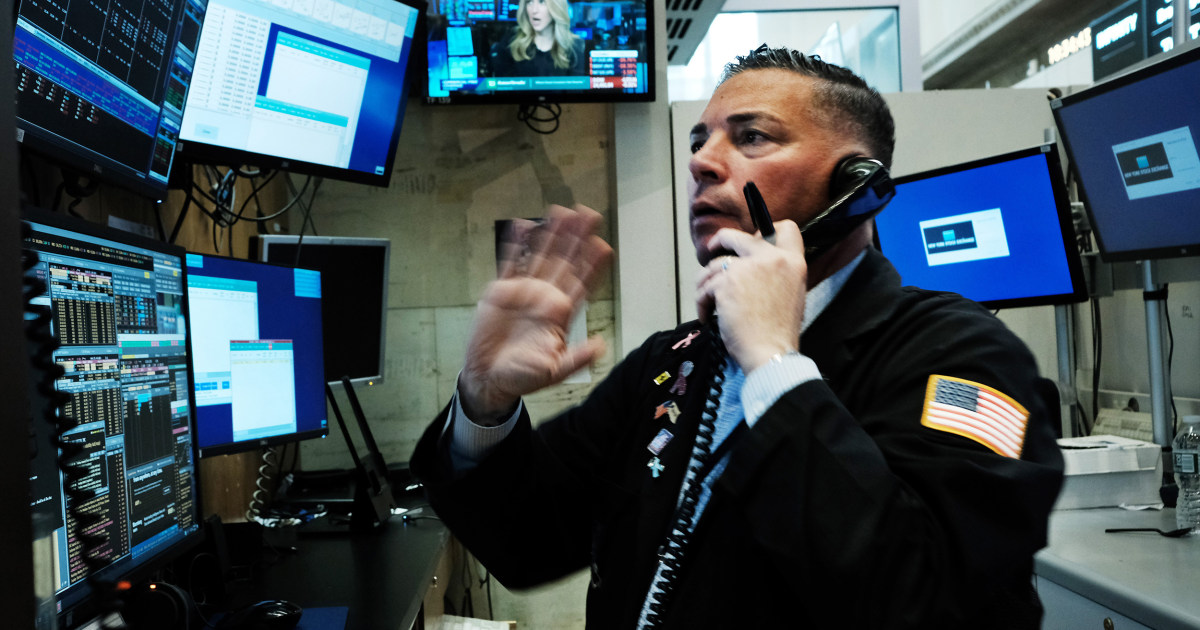 Dow enters bear territory, plunging by more than 1,400 points