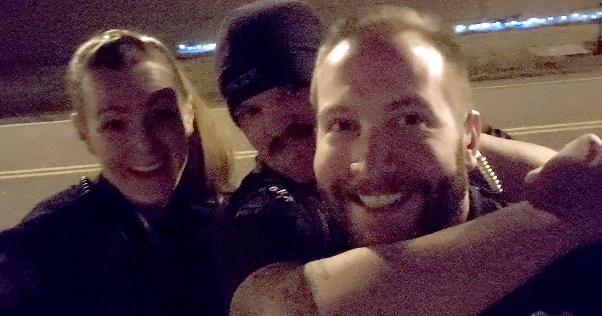 Three Aurora officers fired for taking photos near Elijah