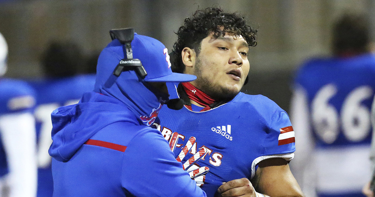 Texas high school football player seen on video tackling referee is charged with assault