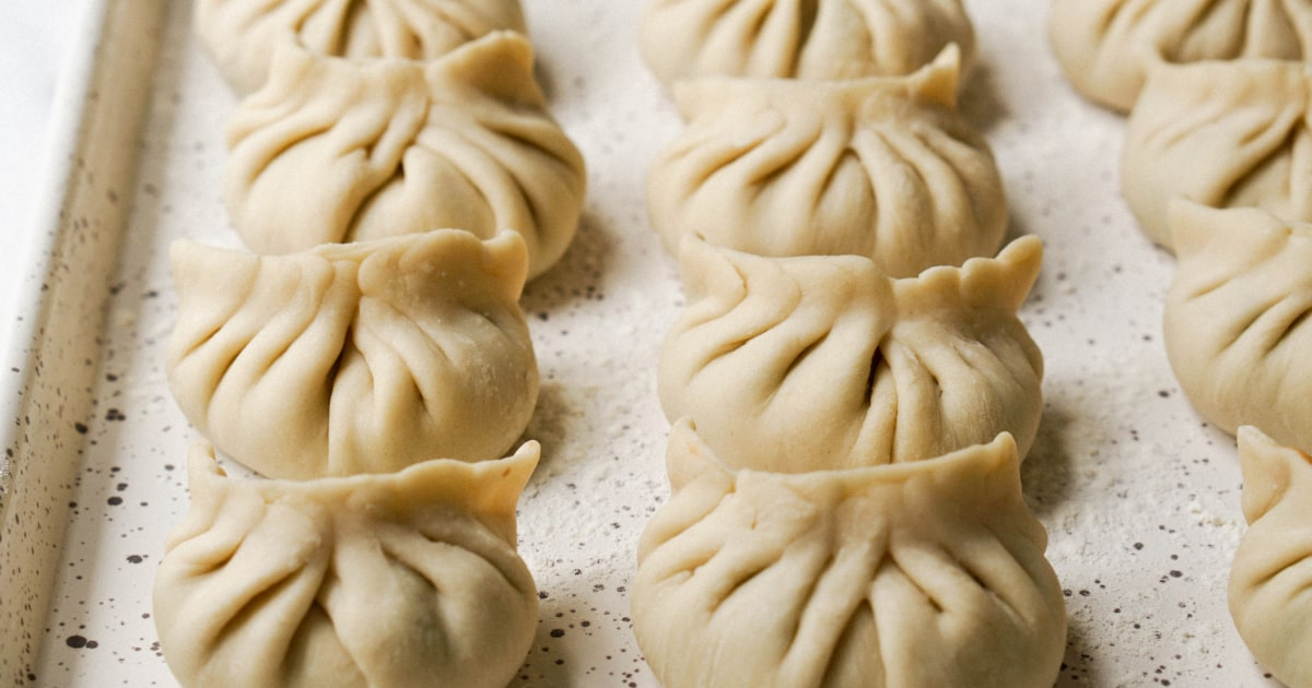 www.nbcnews.com: Yuan bao folds over Zoom: How Lunar New Year dumpling parties went online this year