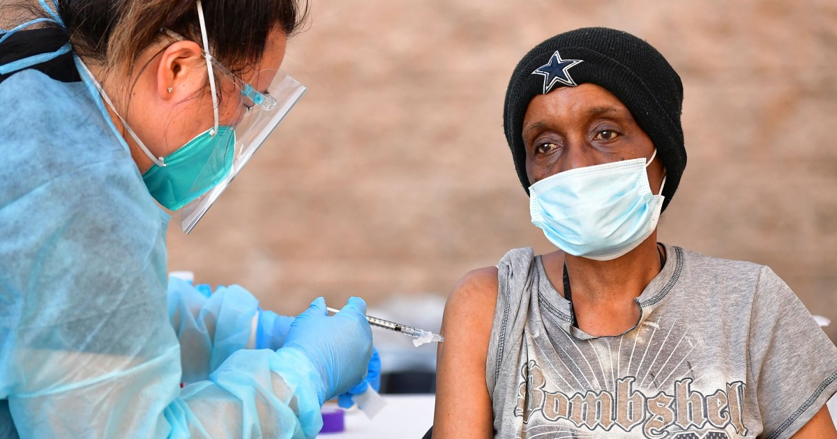 Homeless Americans fear vaccine conspiracies. Here's how cities are intervening. thumbnail