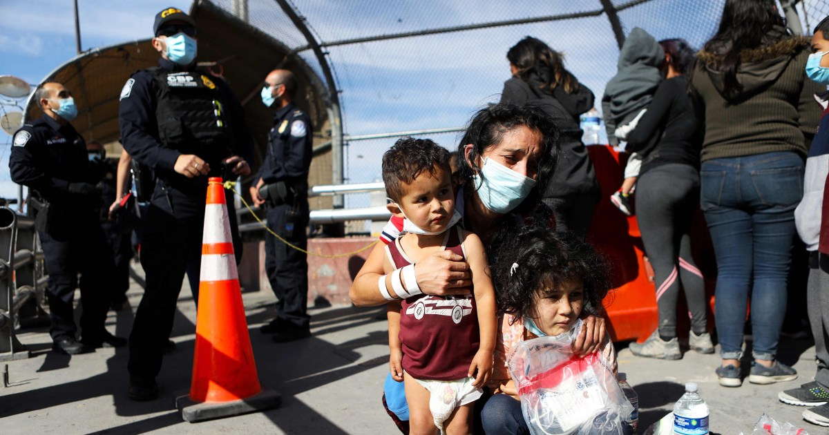 Federal judge halts use of health order to expel migrant families along the border