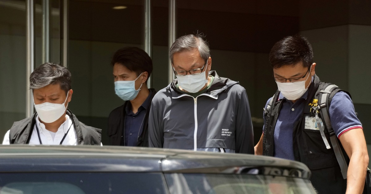 Hong Kong police raid Apple Daily newspaper under national security law, arrest staff