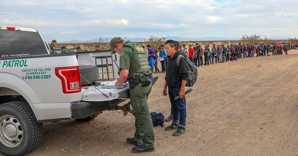 Border Patrol video shows migrants crawling under fence into U.S.