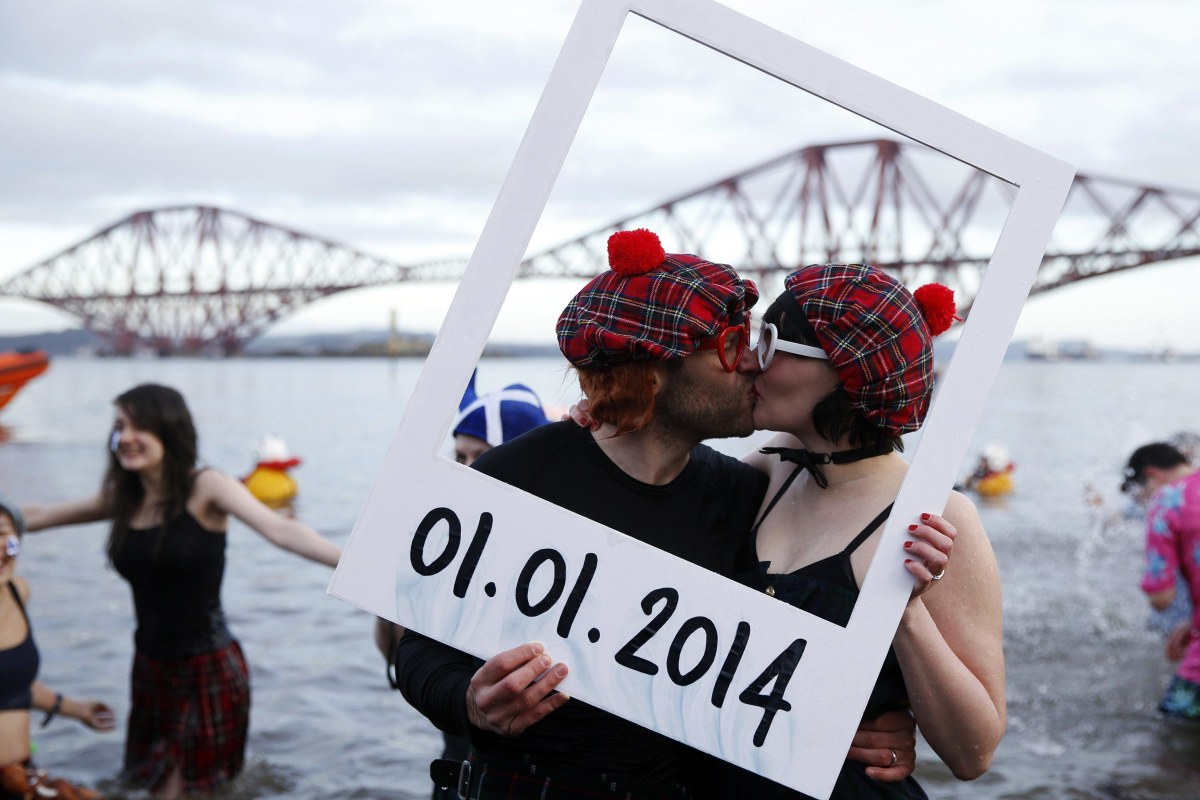 Image: Swimmers in fancy dress participate in the New Year's Day Looney Dook swim at South Queensferry