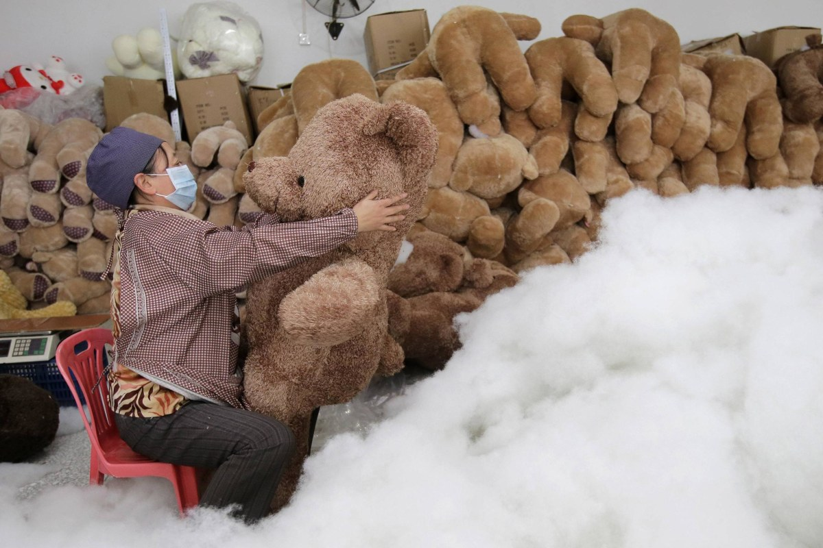 Image: A worker stuffs a toy bear with cotton at a toy factory in Wuhan