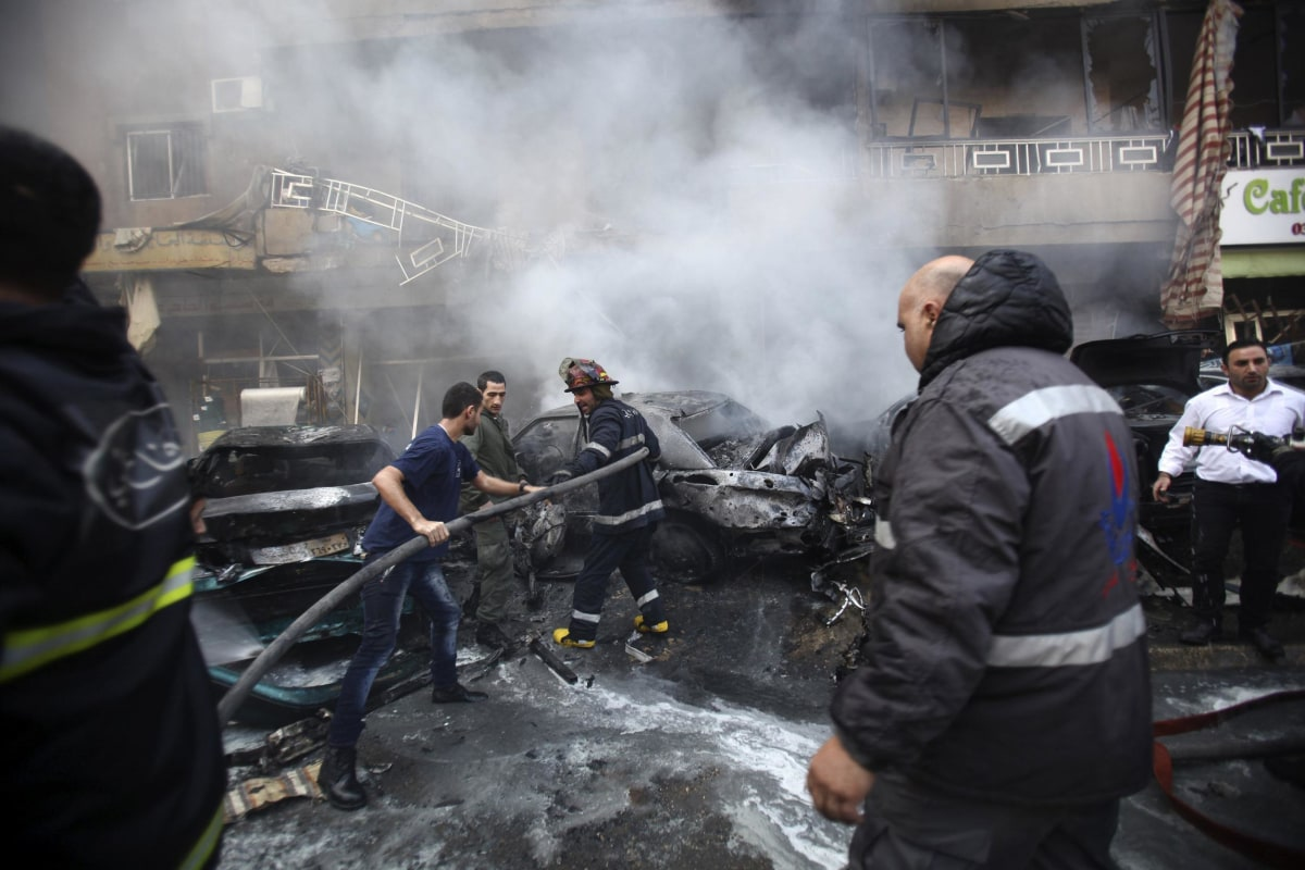 Image: Firefighters extinguish a fire at the site of an explosion in the Haret Hreik area, in the southern suburbs of the Lebanese capital Beirut