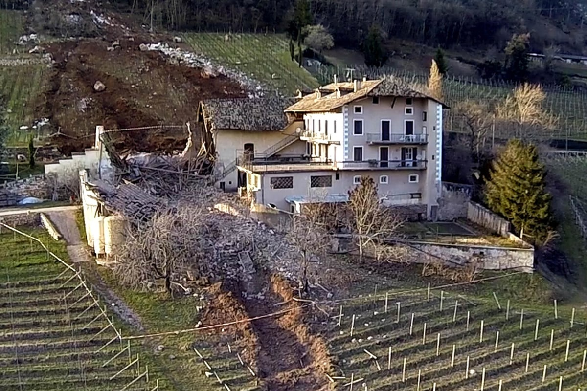 Image: A huge boulder sits near a farmhouse