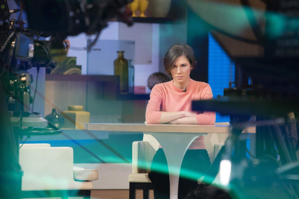 """Image: Amanda Knox sits alone before being interviewed on the set of ABC's """"Good Morning America"""" in New York"""