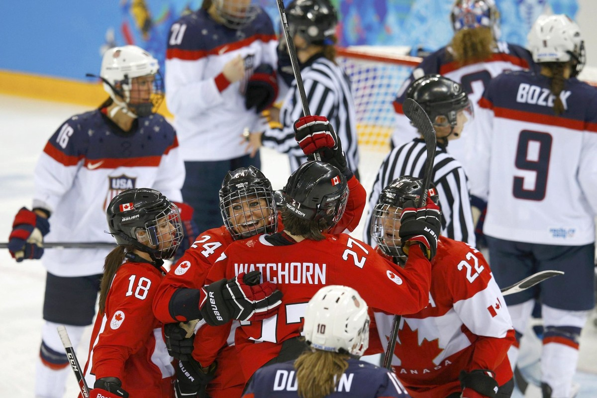 Image: Canada's Wickenheiser celebrates her goal with teammates against Team USA's goalie Vetter during the third period of their women's ice hockey game at the 2014 Sochi Winter Olympics