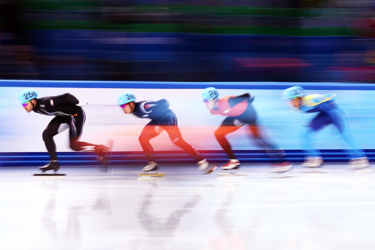 Eduardo Alvarez of the United States (L) leads the pack as he competes in the Short Track Speed Skating Men's 5000m Relay Semifinal on day 6 of the Sochi 2014 Winter Olympics at at Iceberg Skating Palace.