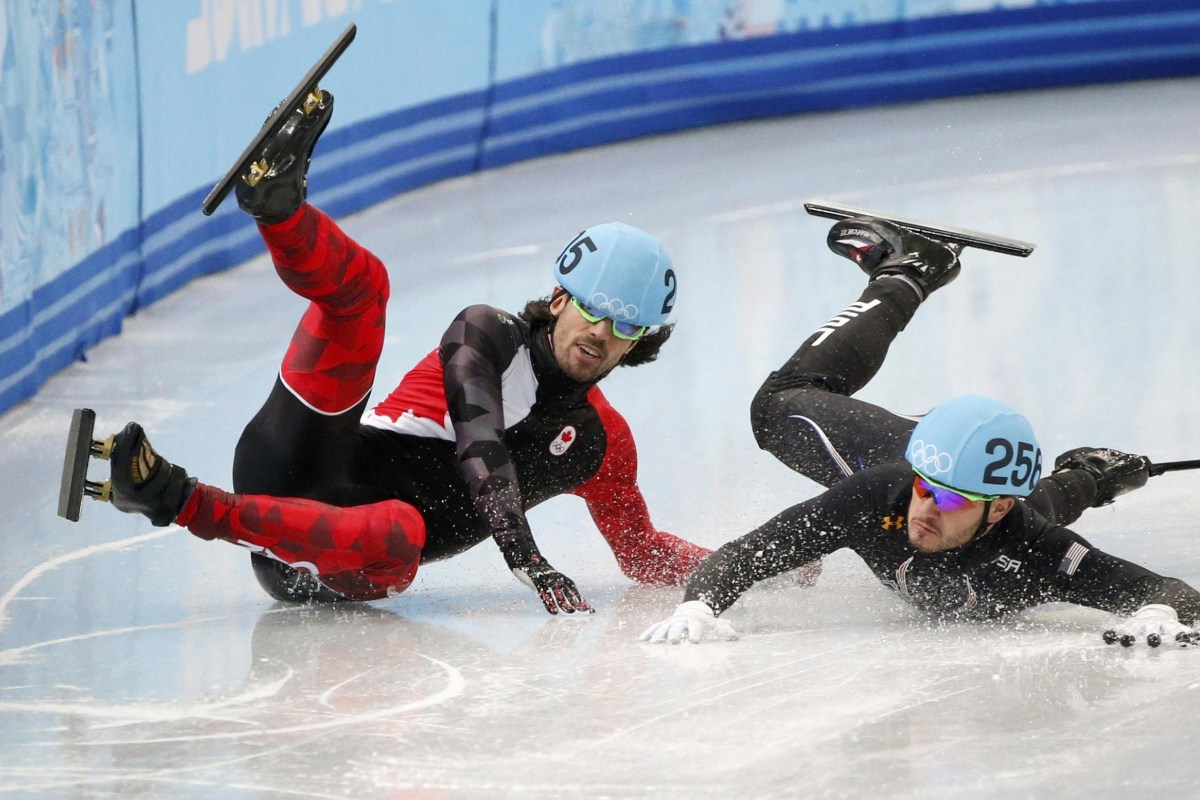 Image: Canada's Charles Hamelin and Eduardo Alvarez of the U.S. fall during the men's 1,000 metres short track speed skating quarter-finals race at the Iceberg Skating Palace at the Sochi 2014 Winter Olympic Games