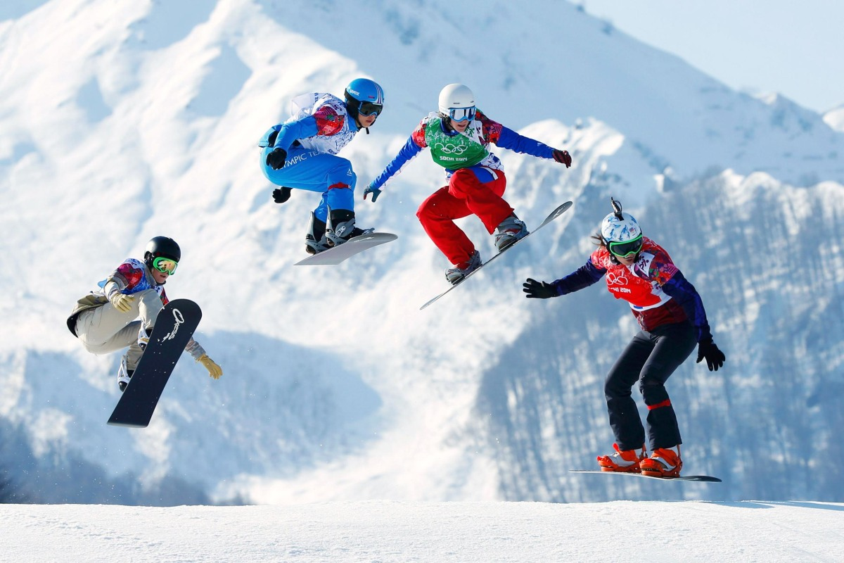 Image: Faye Gulini of U.S., Austria's Maria Ramberger, France's Nelly Moenne Loccoz and Eva Samkova of Czech Republic compete during women's snowboard cross quarter-finals at 2014 Sochi Winter Olympic Games in Rosa Khutor