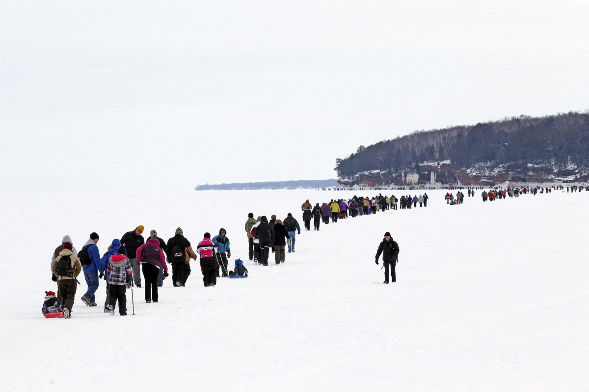 Image: Sightseers trek across a frozen expanse of Lake Superior to the sea caves of the Apostle Islands National Lakeshore
