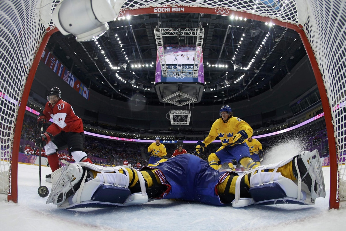Image: Canada's Crosby scores on a breakaway past Sweden's goalie Lundqvist during the second period of their men's ice hockey gold medal game at the Sochi 2014 Winter Olympic Games