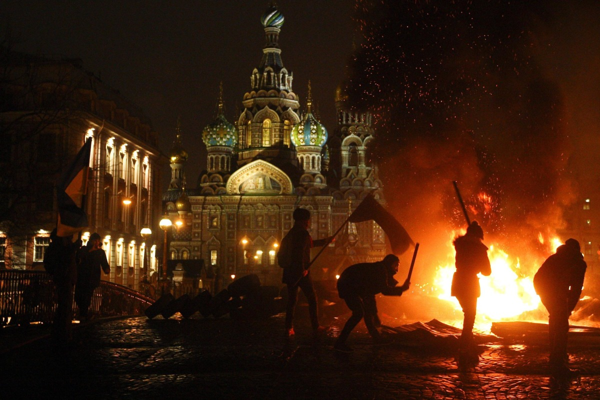 Image: Russian opposition activists hold protest in support of the revolution in Ukraine, burning car tires in the center of St Petersburg,