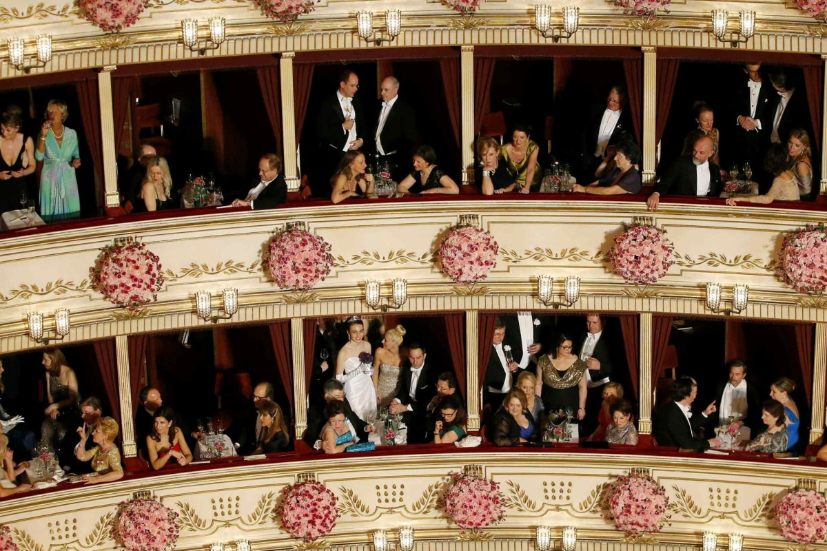 Image: Visitors watch the opening ceremony of the Opera Ball in Vienna