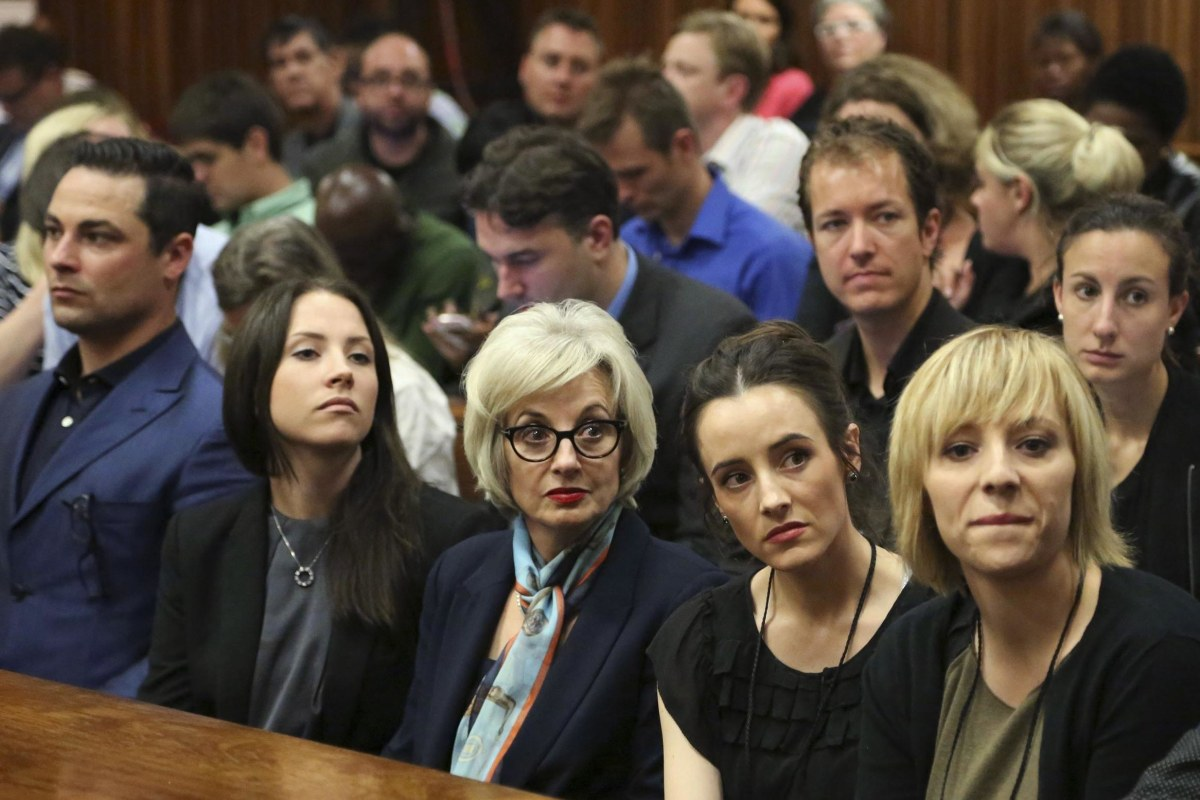Image: The family members of Pistorius sit in court ahead of his trial in Pretoria