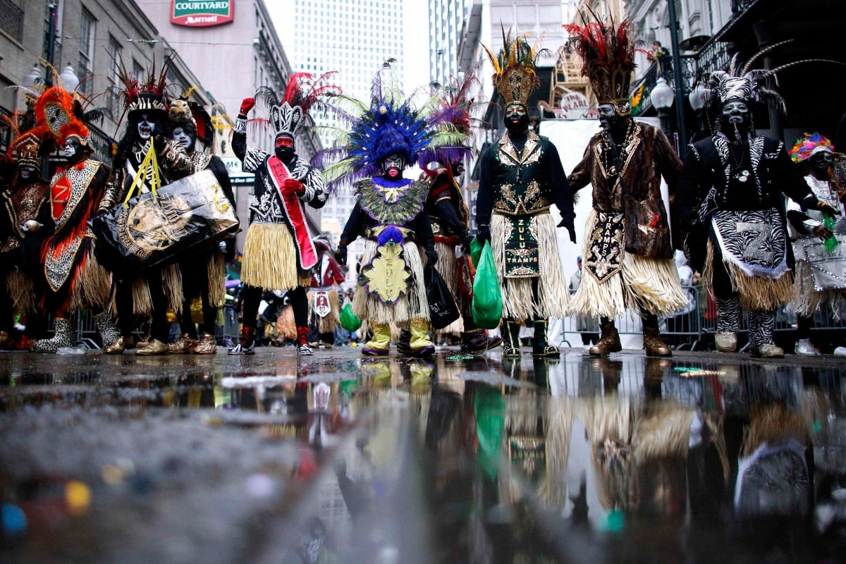 Image: Members of the Krewe of Zulu parade down St. Charles Avenue on ...