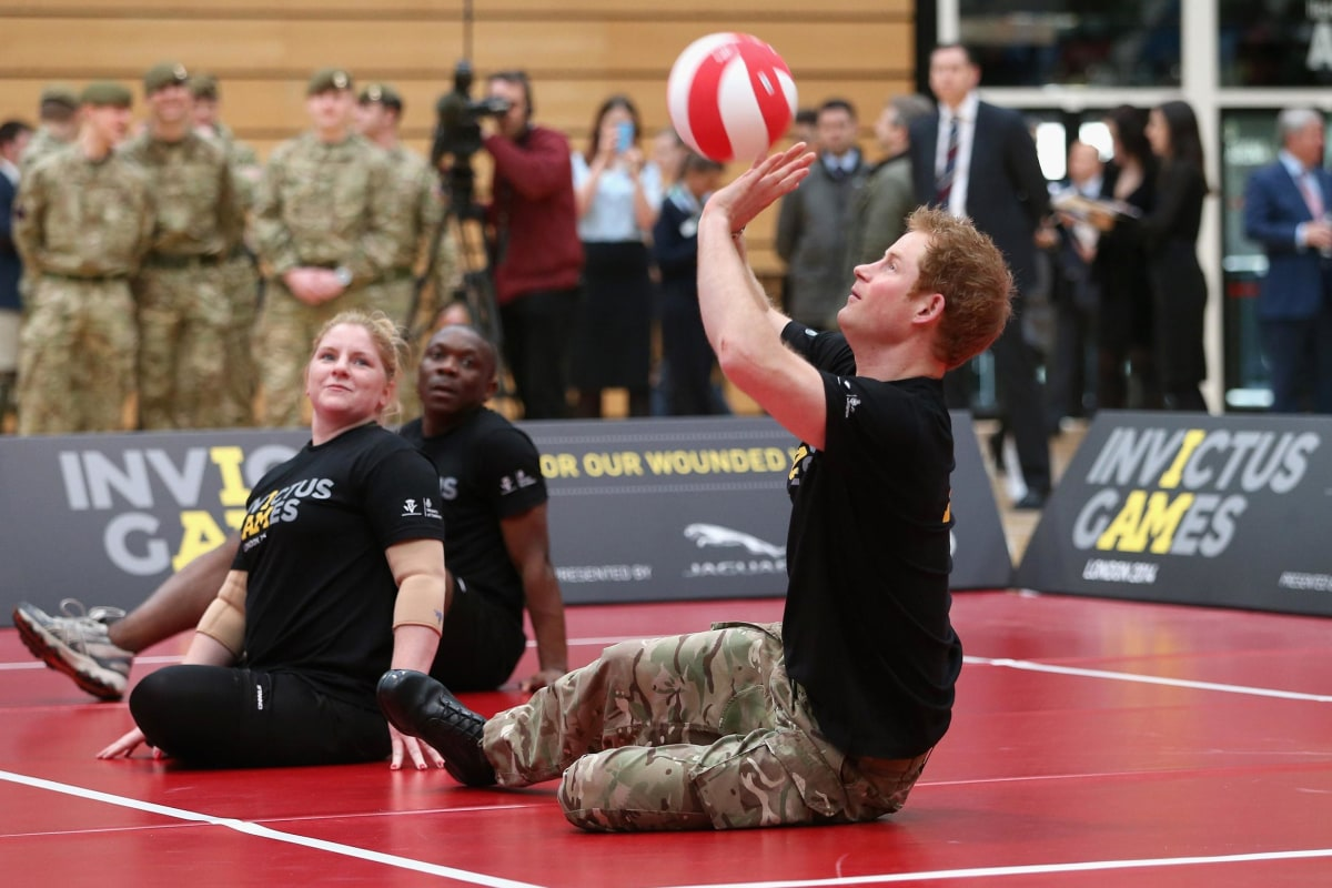 Image: Prince Harry plays sitting volleyball at the launch of the Invictus Games