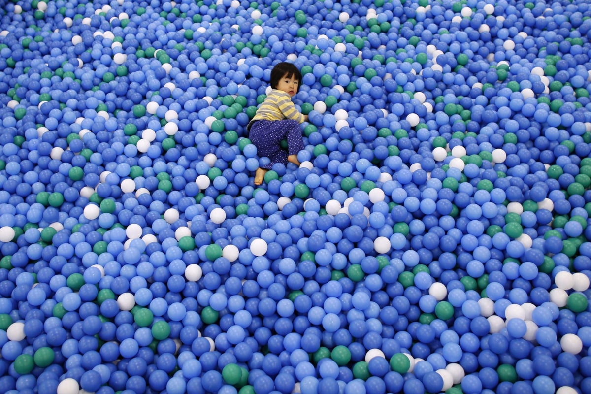Image: Two-year-old Nao Watanabe plays in a ball pit at an indoor playground which was built for children and parents who refrain from playing outside because of concerns about nuclear radiation in Koriyama.