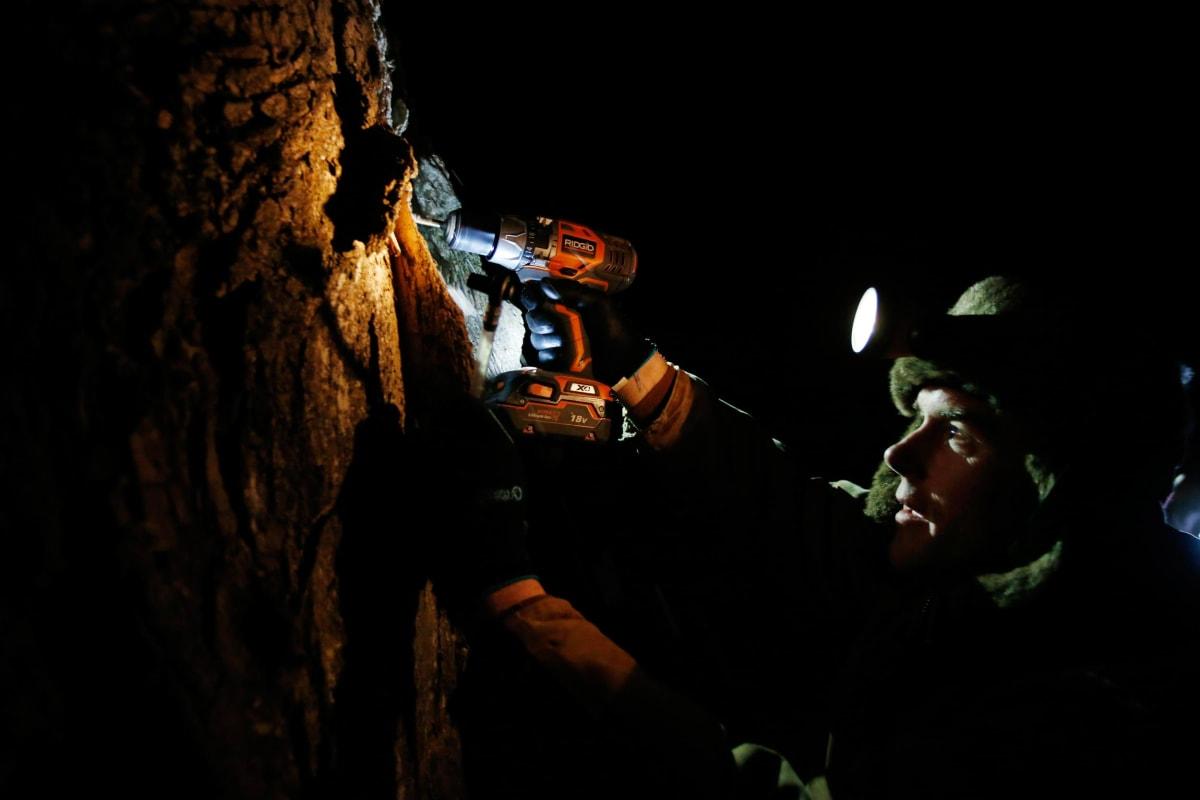 Image: Turtle Lane Maple farmer Paul Boulanger taps a maple tree by headlamp