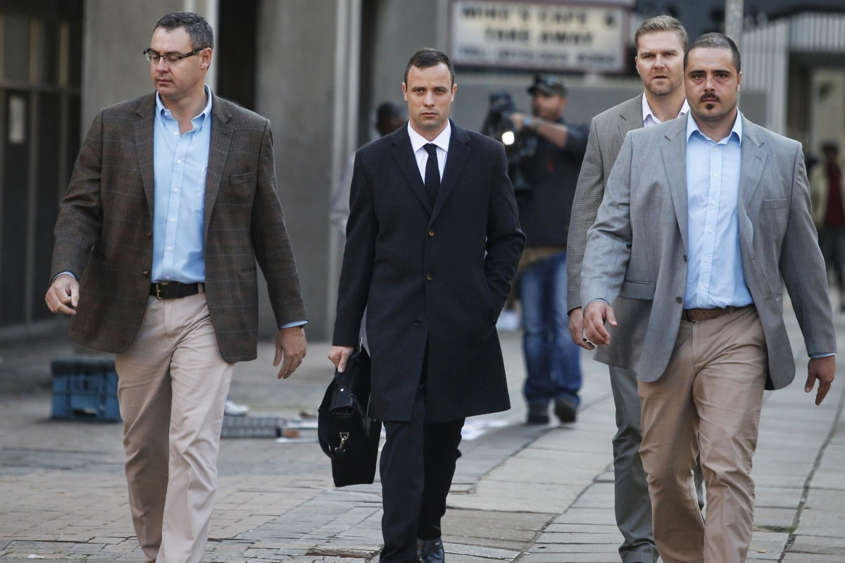 Image: South African Paralympic track star Oscar Pistorius arrives at court in Pretoria