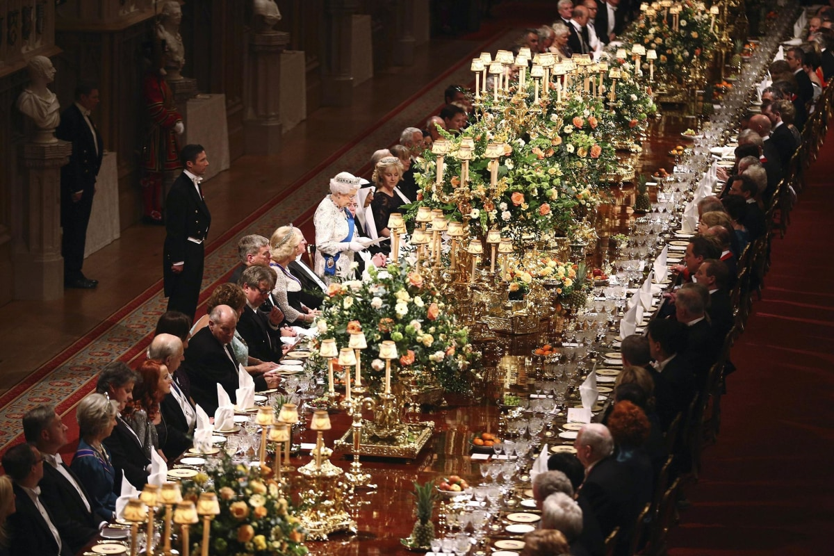 Image: Guests listen during a speech by Britain's Queen Elizabeth II in honour of Ireland's President Higgins during the Royal Banquet in Windsor