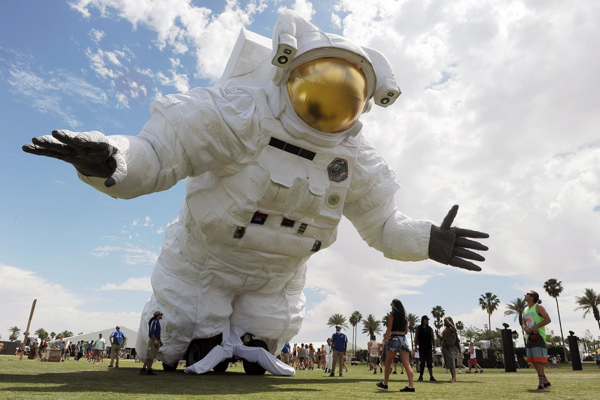 "Image: The ""Escape Velocity"" moving sculpture by artist group Poetic Kinetics looms over Coachella festival-goers on the Empire Polo Field"