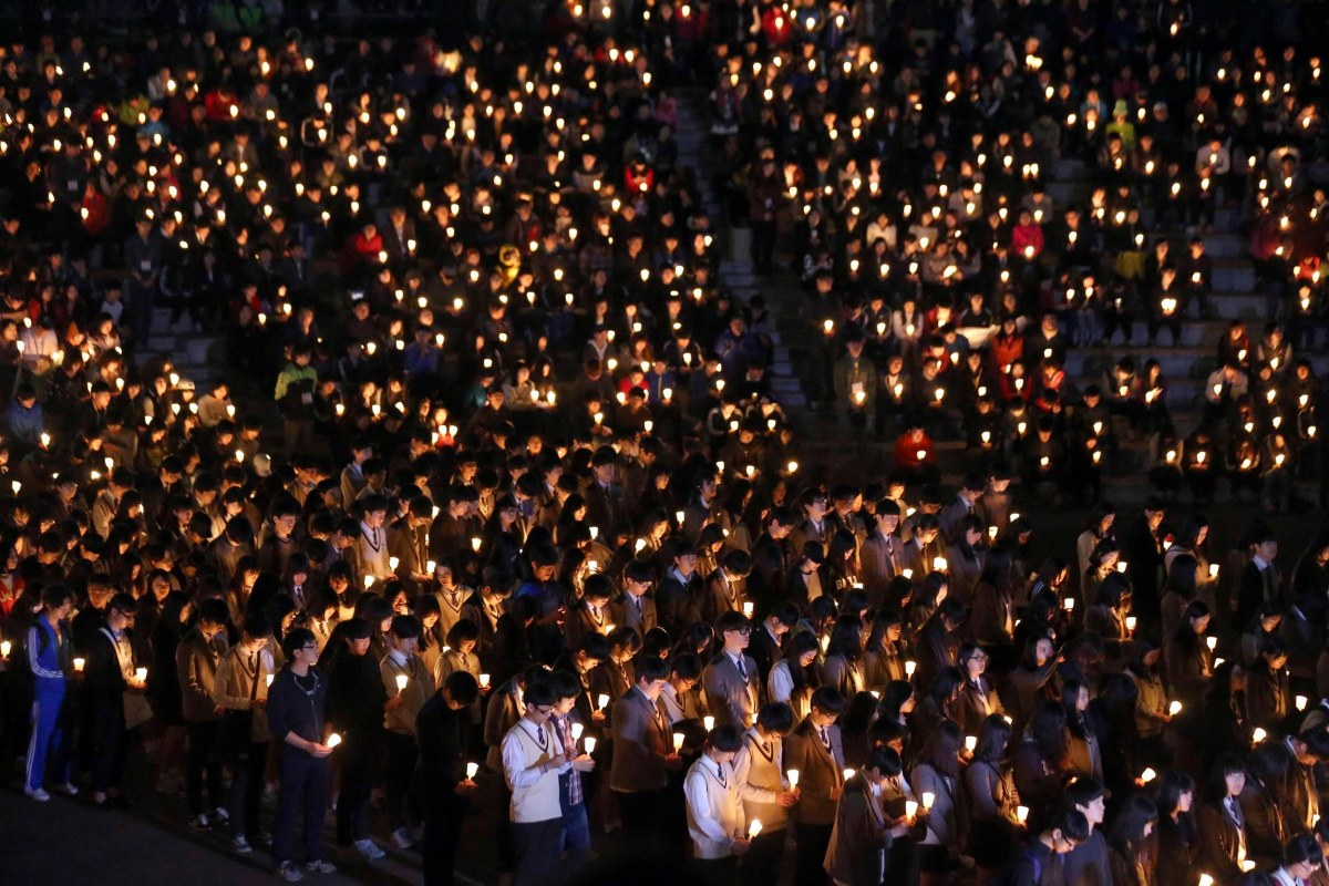 "Image: Students from Danwon high school and other people attend candlelight vigil to wish for safe return of missing passengers from South Korean ferry ""Sewol"", which sank in the sea off Jindo, in Ansan"