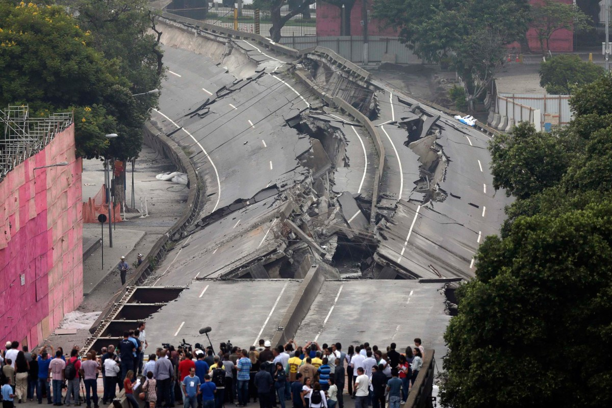 Image: People gather to observe the Perimetral overpass, after its partial demolition as part of Rio's Porto Maravilha urbanisation project, in Rio de Janeiro
