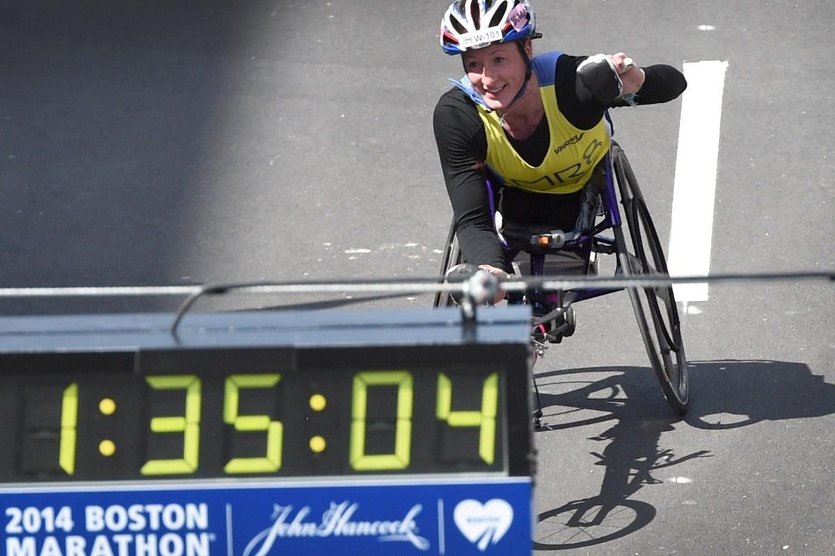 Image: Tatyana McFadden of the U.S., comes down Boylston Street on her way to winning the Women's Push Rim Wheelchair division
