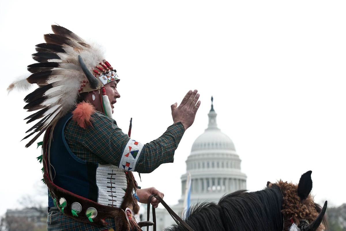Image: A Native American tribal leader sits on his horse in front of the U.S. Capitol in Washington as the Cowboy and Indian Alliance protest the proposed Keystone XL pipeline
