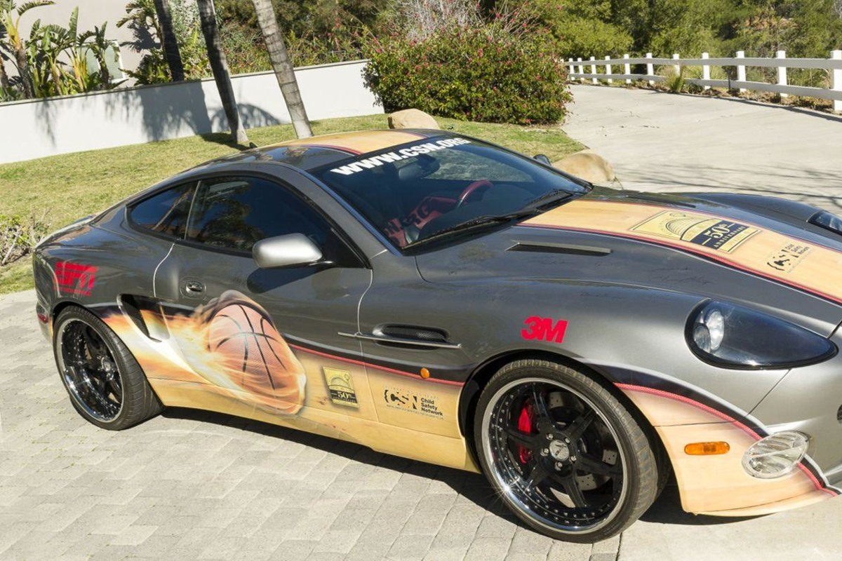 This 2002 Aston Martin Vanquish features the signatures of 50 basketball Hall of Famers.