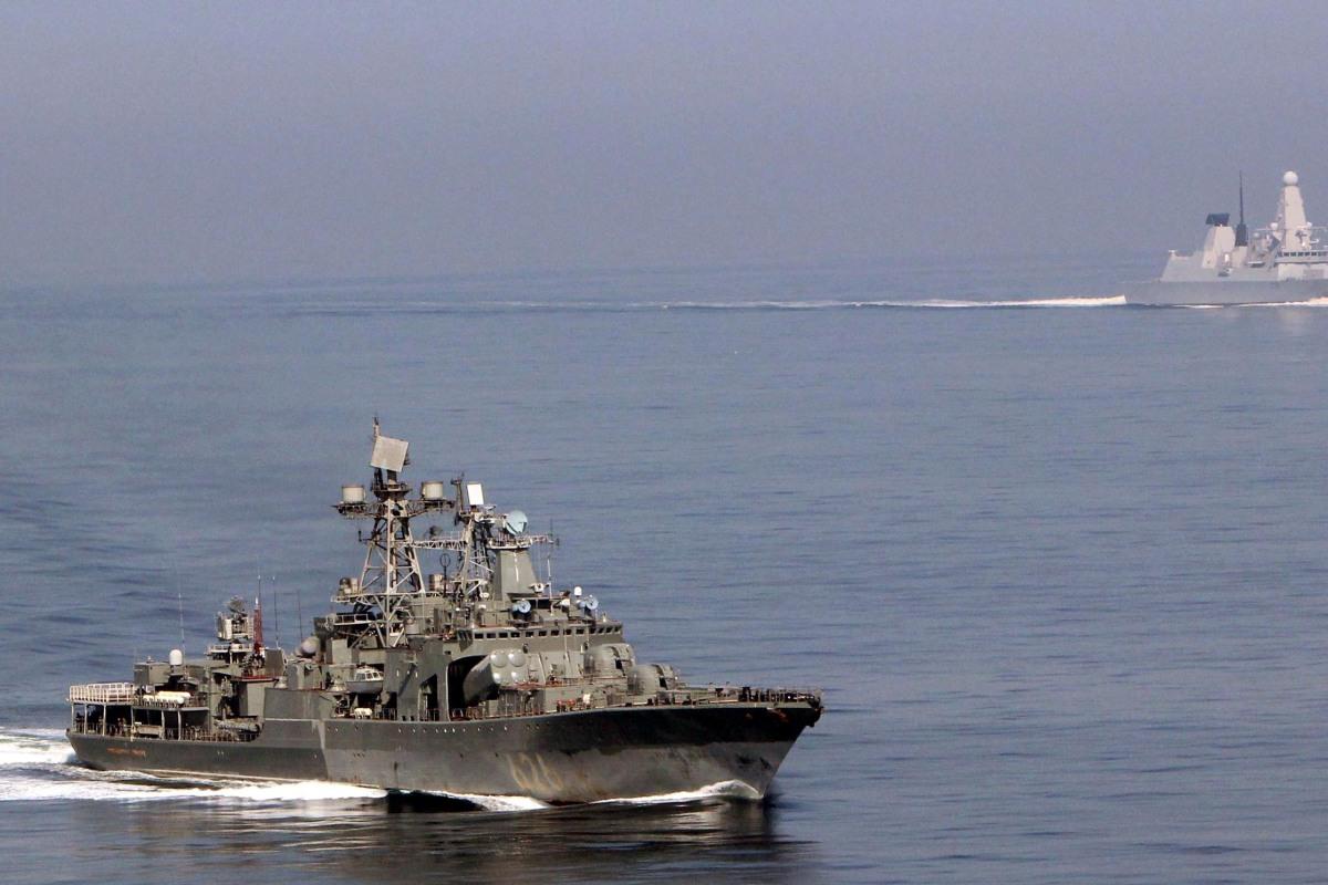 HMS Dragon eyes a Russian destroyer